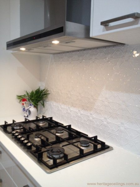 An easy to install DIY splashback. For more information see: http://www.heritageceilings.com.au/tempat/original.php