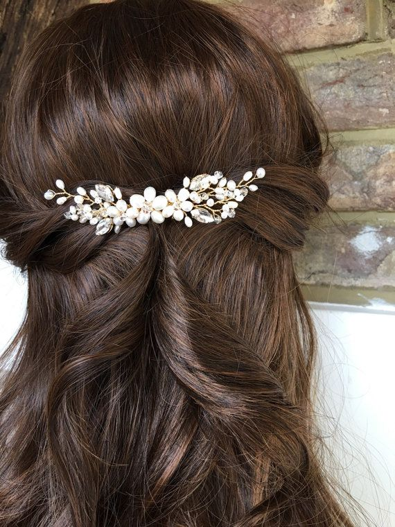 A pretty and simple wedding hair comb featuring ivory tone freshwater pearls, navette stones and shimmering crystals. Perfect for a simple hairstyle and