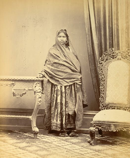 Portrait of a girl from Sindh, showing method of wearing ear and nose rings, wristlets and anklets - 1870s - Old Indian Photos