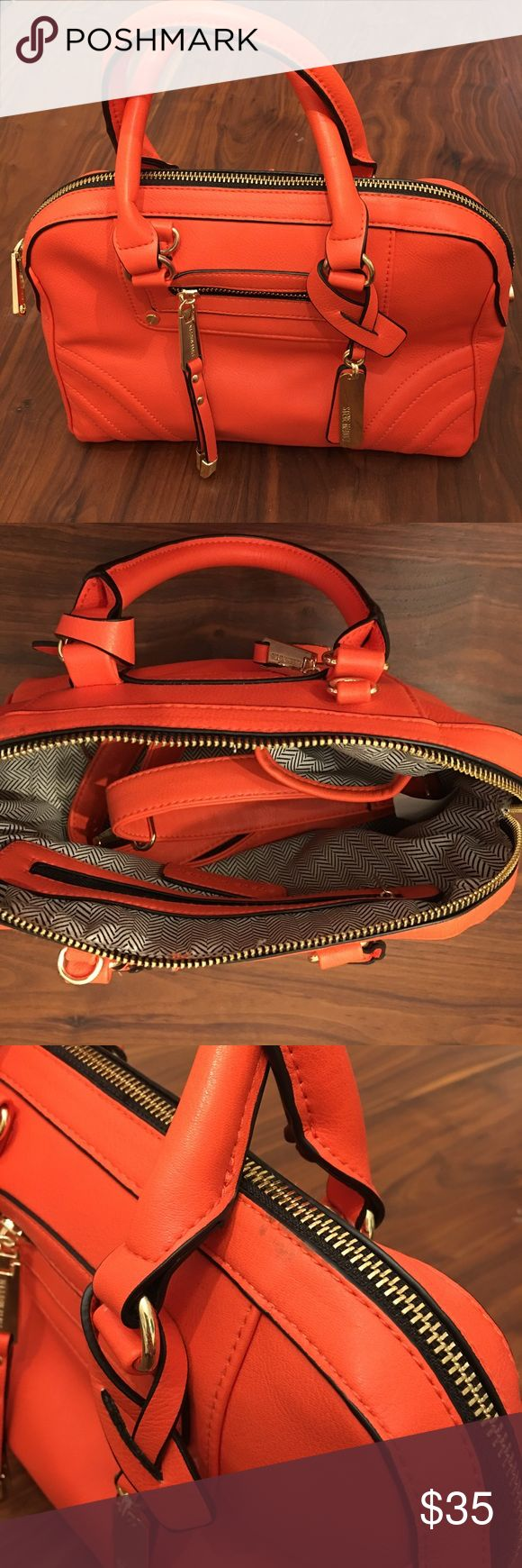 Steve Madden Bright Orange Hand Bag I have a bright orange handbag by Steve Madden for sale, make an offer! It is clean inside and only worn once. It has a black scuff on the back that may or may not come out, I haven't tried. Didn't bother me too much and was perfect colored for Giants games. I have a Dooney SF Giants bag now so I don't need this one! Comes with an adjustable handle. Steve Madden Bags Satchels