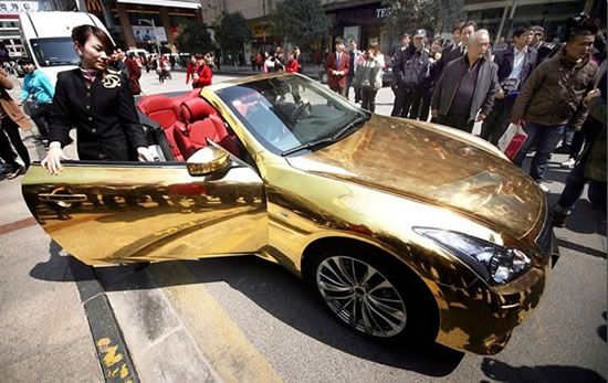 A Chinese Gold wrapped Infiniti G-37 gets towed away by police