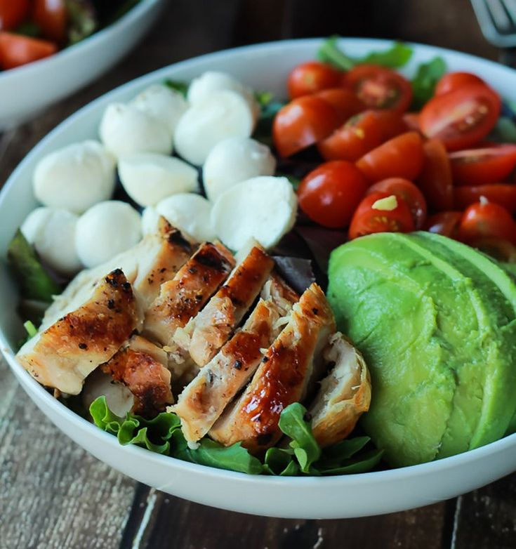 Joyful Healthy Eats Avocado Caprese Chicken Salad With Balsamic Vinaigrette takes the classic salad up a notch by adding creamy sliced avocado, smoky grilled chicken, and serving it all over a bed of greens.
