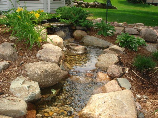Best 25 garden stream ideas on pinterest modern pond for Landscaping rocks des moines