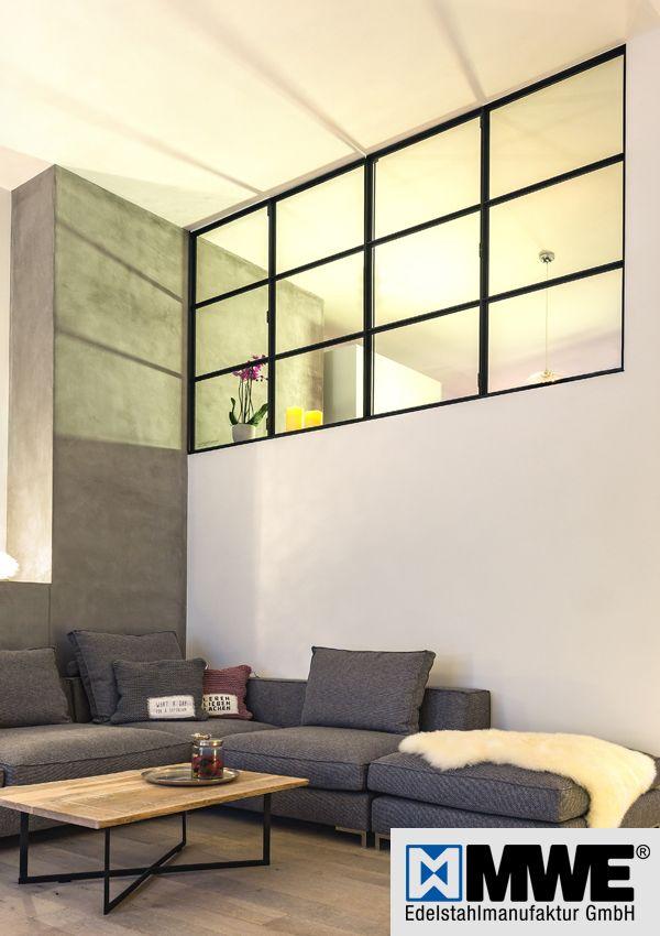 Filigrane Trennwände aus Glas und schwarzem Stahl…