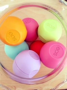 Display EOS lip balm in a glass candy jar. :) + other colorful small things, like mini hand sanitizers. App. $20