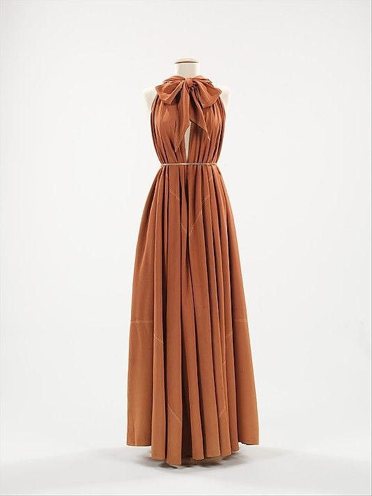 "Evening dress, 1945, Claire McCardell Met Museum Collection - Thought of as the ""future dress,"" the design of this iconic piece is simply two pieced triangles that are tied at the neck."