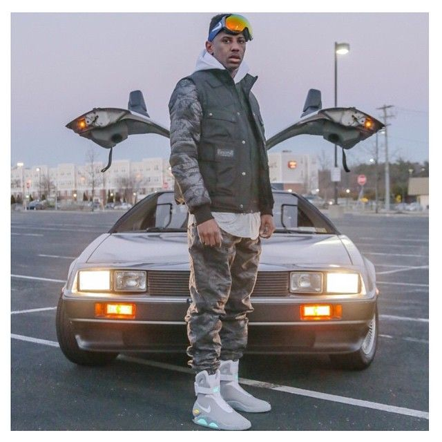 This pin shows Rapper Fabolous in a pair of Nike Air Mags with the Delorean behind him #TheSoleLibrary #FamousSoles