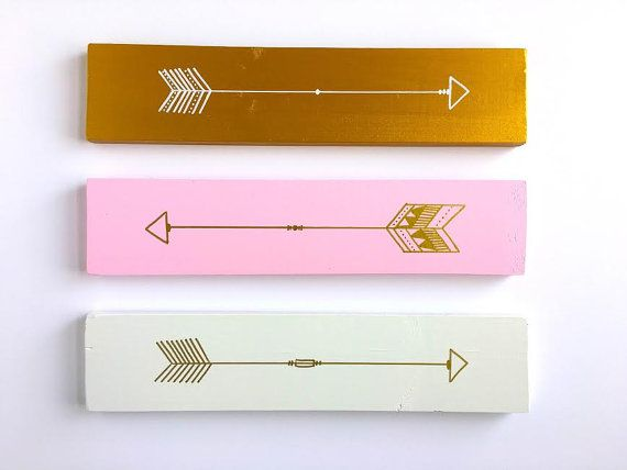 Incorporate a sense of adventure and fun into your decor with these Pale Pink, Gold, and White arrow signs! This sweet color combination will look