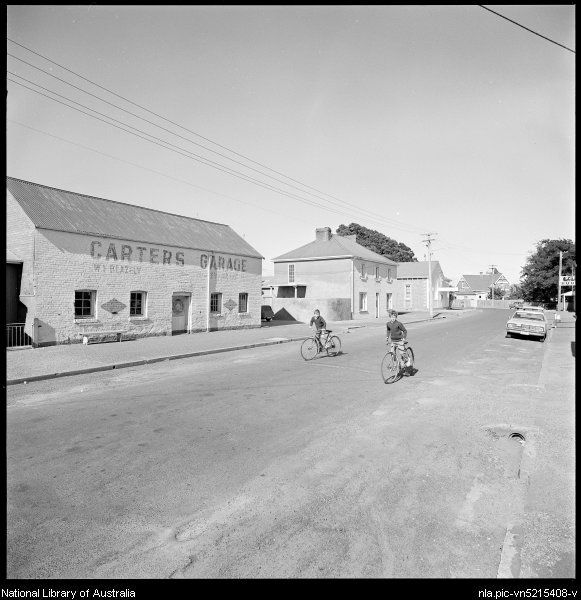 Carter's Garage viewed along street and buildings, Evandale, Tasmania, ca. 1970
