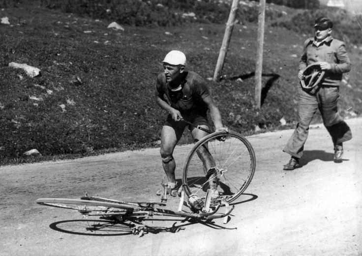 During the descent of the Col d'Aspin in 1936 Cyclist Romain Maes tries to pump up a flat tire only to discover he also has a broken pump
