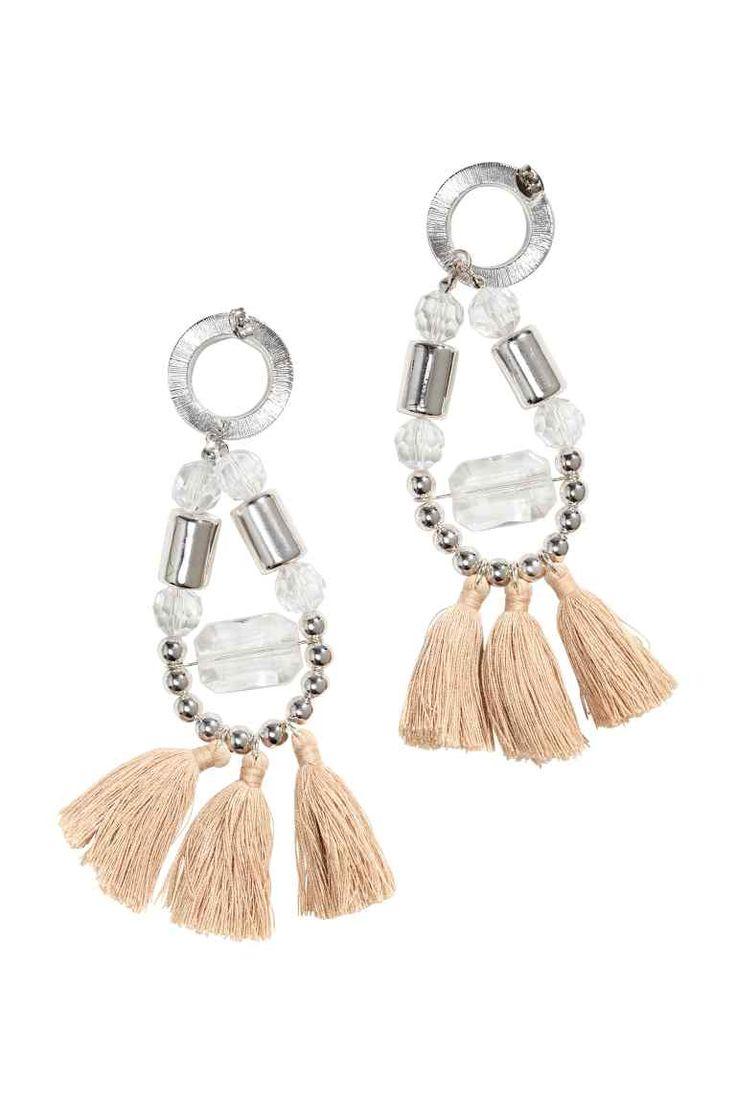 Earrings with tassels: Long metal earrings with plastic beads and tassels. Length 11.5 cm.