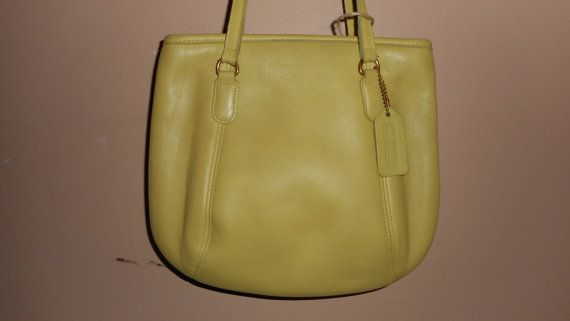 QUALITY NEVER GOES OUT OF STYLE! PRETTY CHARTREUSE COLOR. MADE IN USA. 11 X 10 X 3. STRAPS MEASURE 11. CLEAN INSIDE AND OUT