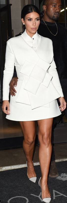 Who made Kim Kardashian's white bow dress and clear pumps that she wore in…