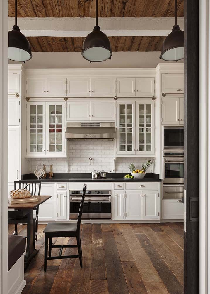 dreamy kitchen with industrial lighting and wide plank flooring