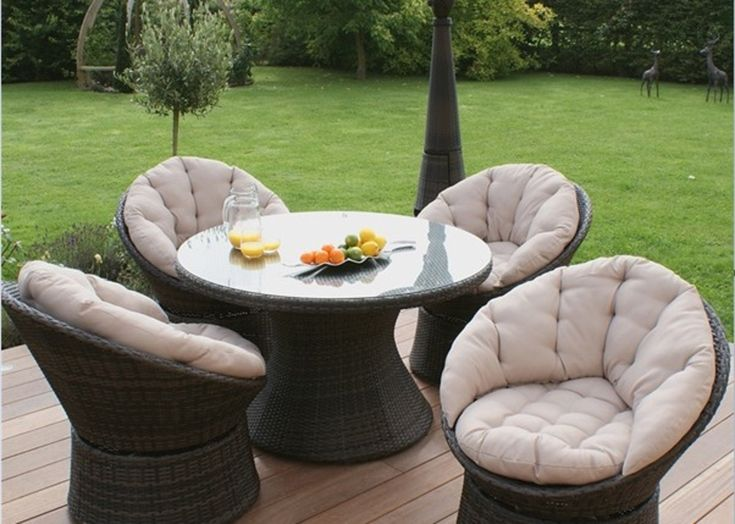 700 set of four swivel chairs and one dining round table - Garden Furniture Glasgow