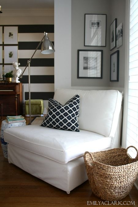 Sooo many things I like here...and will duplicate with my own twist... Mix of patterns, frame arrangements, grouping of 9 frames with large mats, and last but not least, the striped wall! That will happen... Great blog!