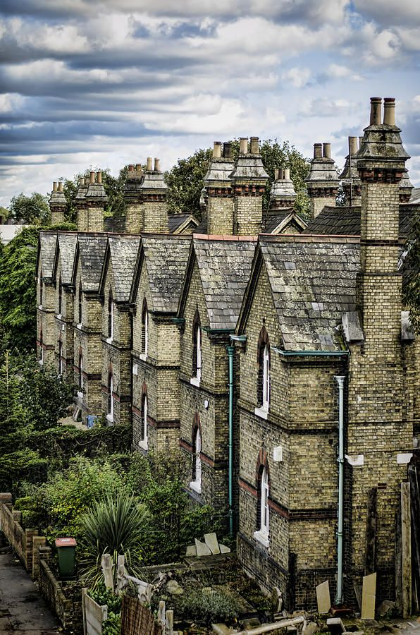 A row of older Victorian houses in East London.