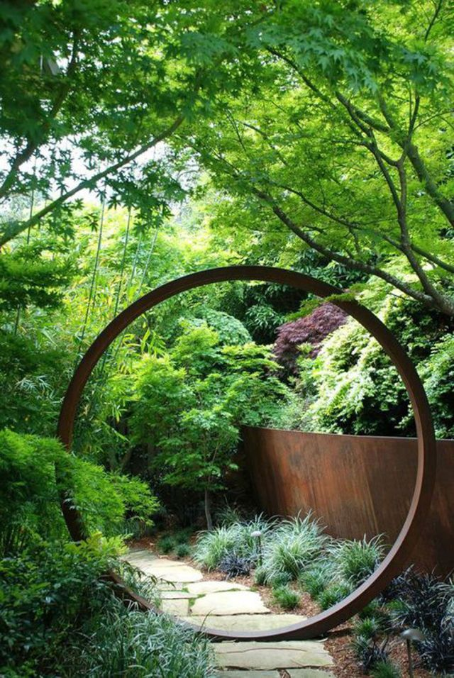 """For a zen influence, divide your garden into two sections by installing a circular opening or """"moongate"""" onto a fence or trellis. More"""