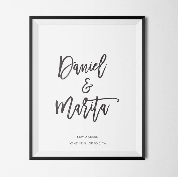 This minimalist design features a couple's names in modern calligraphy, anchored by their special place coordinates.