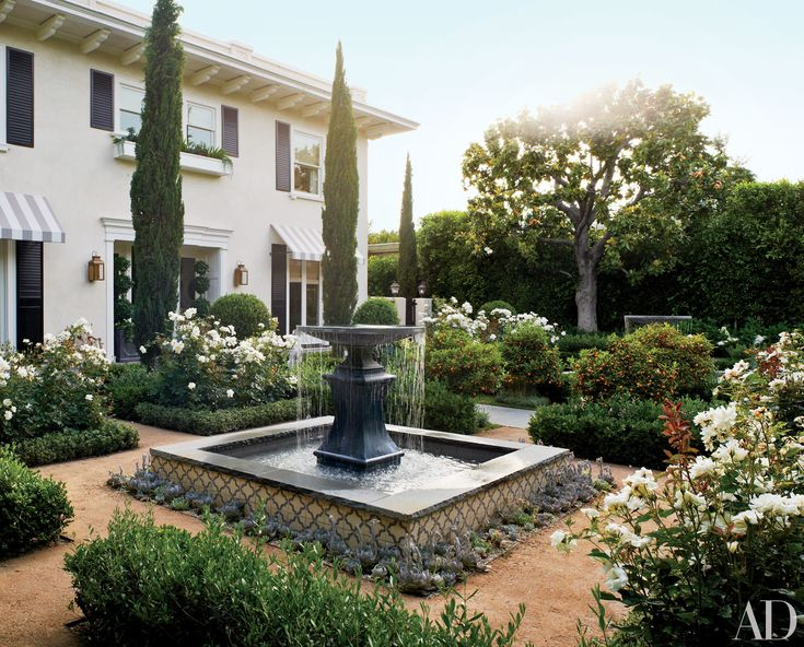 In the entrance courtyard of a Los Angeles home, local firm Modern Floristry designed the Italianate garden, which includes a pair of lead fountains (one is shown) from Authentic Provence.