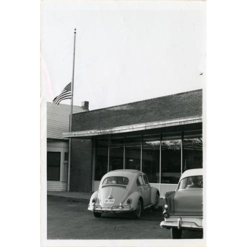 Oak Cliff Post Office flag at half-mast.