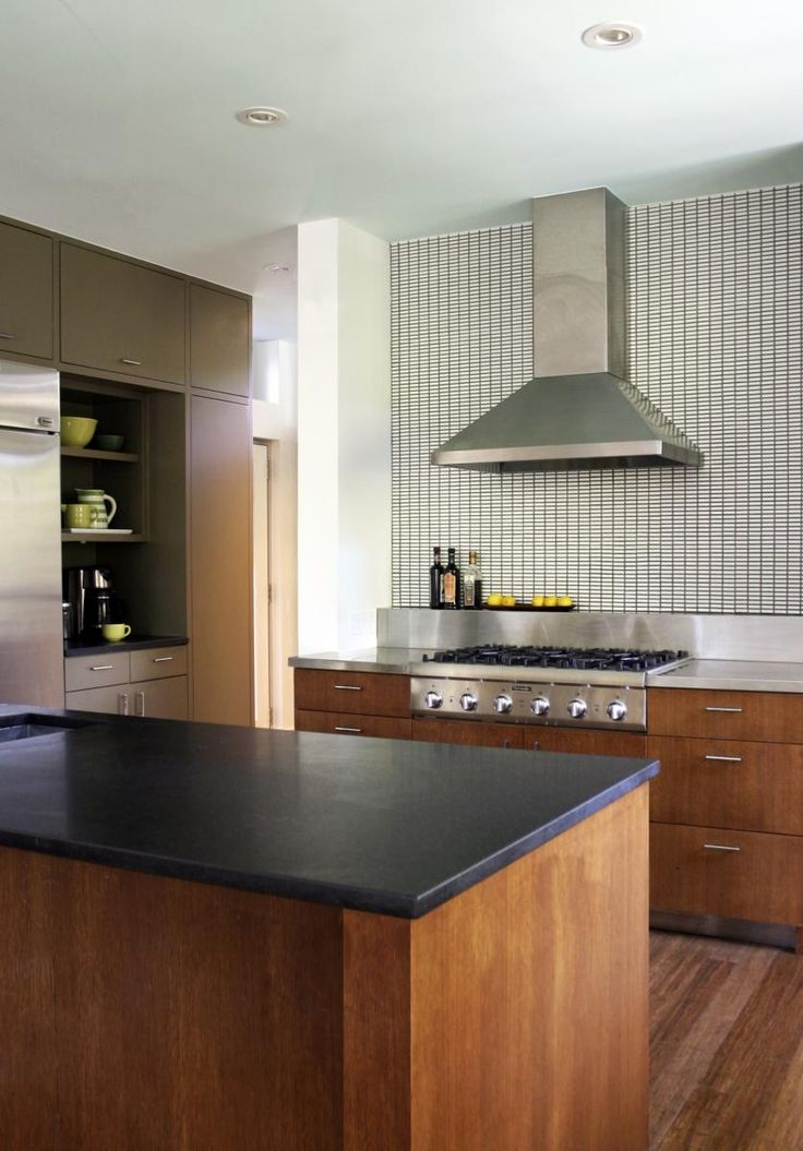 Simple eclectic mix of materials - Stainless steel, Honed Granite, Woods, Painted cabinets, and glazed tile. (Cultivate.com)