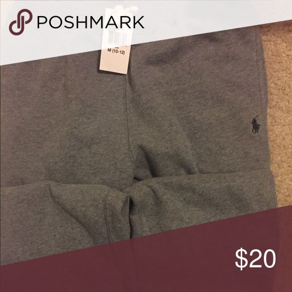 Ralph Lauren Polo sweatpants Cotton blend fleece pants  Signature embroidered pony below the left pocket Ribbed elasticized drawstring waist Two front angled pockets 4th pic shows two stains or dots, not sure what it is. Possibly something in a box from our last move. Polo by Ralph Lauren Bottoms Sweatpants & Joggers