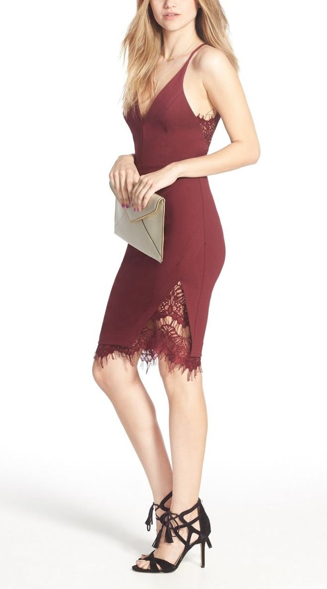 Feminine lace adds intriguing texture to this alluring body-con dress styled with flattering front darts and a cool asymmetrical hem. Easily pair with black sandals and a clutch for a glamorous look.