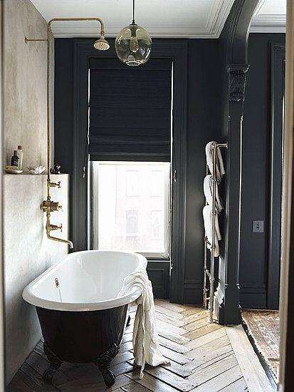 Classic Chic Bathroom... love the beautiful black claw foot tub & wood floor