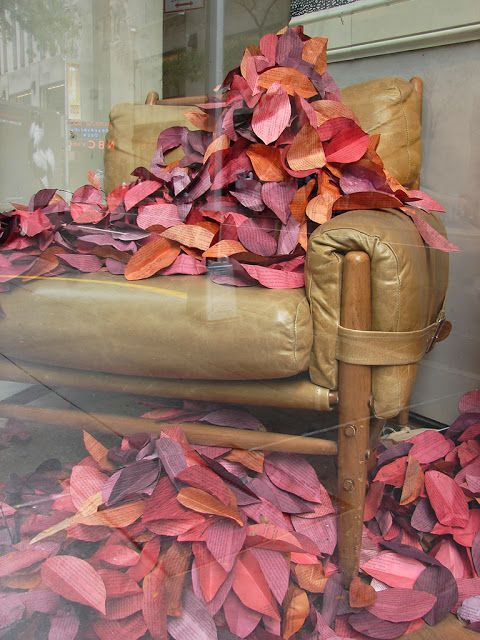 Anthropologie window display. The leaves are cut from the pages of a book.