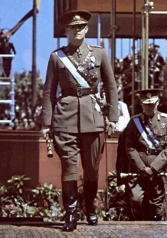 King Michael of Romania, circa 1940, with his Marshal's baton at a military parade in Bucharest, Romania. Behind him stands Marshal Antonescu, 'Conducator' or military dictator of Romania holding his baton.
