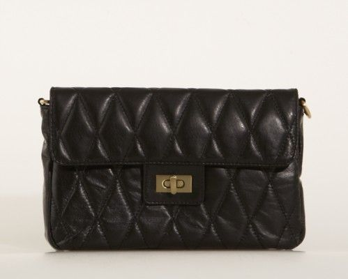 Black quilt bag similar to this one. Bought in a thriftstore in February 2013. Redonated since I mainly use my YSL mail clutch.
