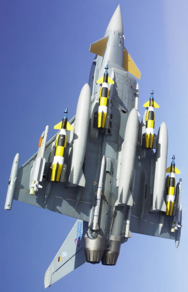 Typhoon Fully Loaded. My God that's a lot of ordnance. Seemingly evading the principles of flight.....