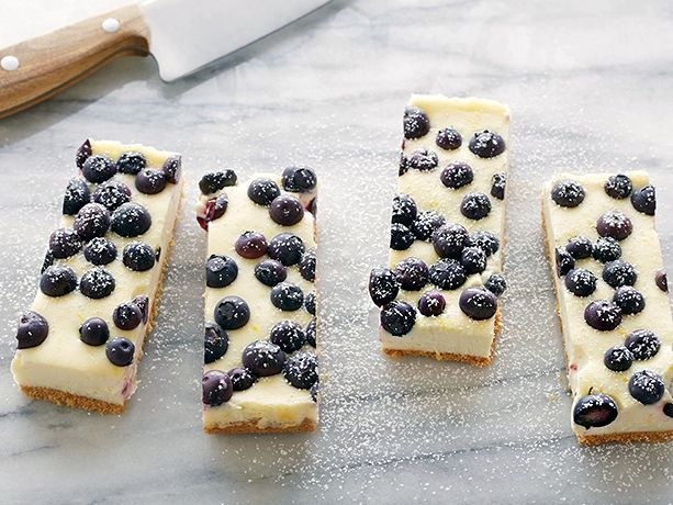 Lemony cheesecake was meant to be studded with in-season blueberries, especially when built on a graham cracker crust.
