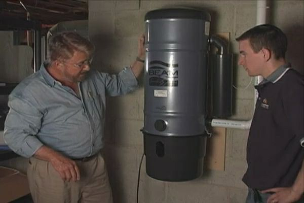 Learn how to install a central vacuum system with outlets on four floors and hidden PVC piping.