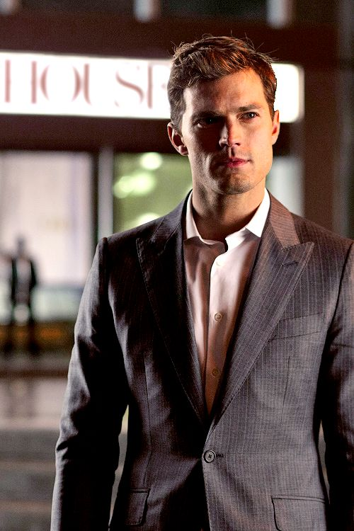 New still of Christian Grey!! Powerful, dominant,and maybe a little amused!! Has Christian Grey finally met his match?! everythingjamiedornan.com