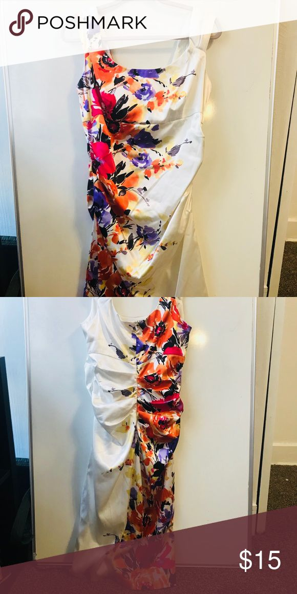 Floral Dress This beautiful floral dress is ruched in all the right places! Pretty for weddings, and spring formal events. London Times Dresses