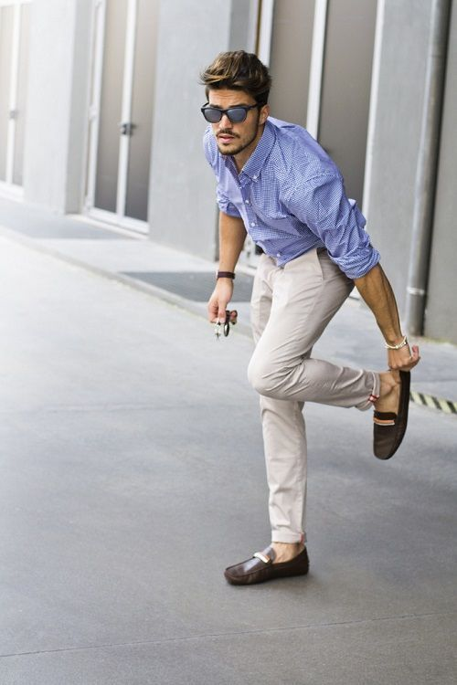 Shop this look on Lookastic: https://lookastic.co.uk/men/looks/light-blue-gingham-long-sleeve-shirt-beige-chinos-dark-brown-leather-driving-shoes/18775   — Light Blue Gingham Long Sleeve Shirt  — Beige Chinos  — Dark Brown Leather Driving Shoes