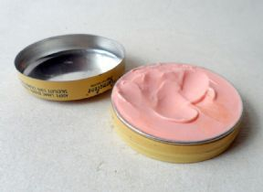 Pink Germolene in metal tins.