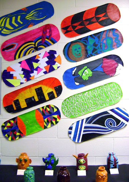 skateboard design project completed with acrylic paint
