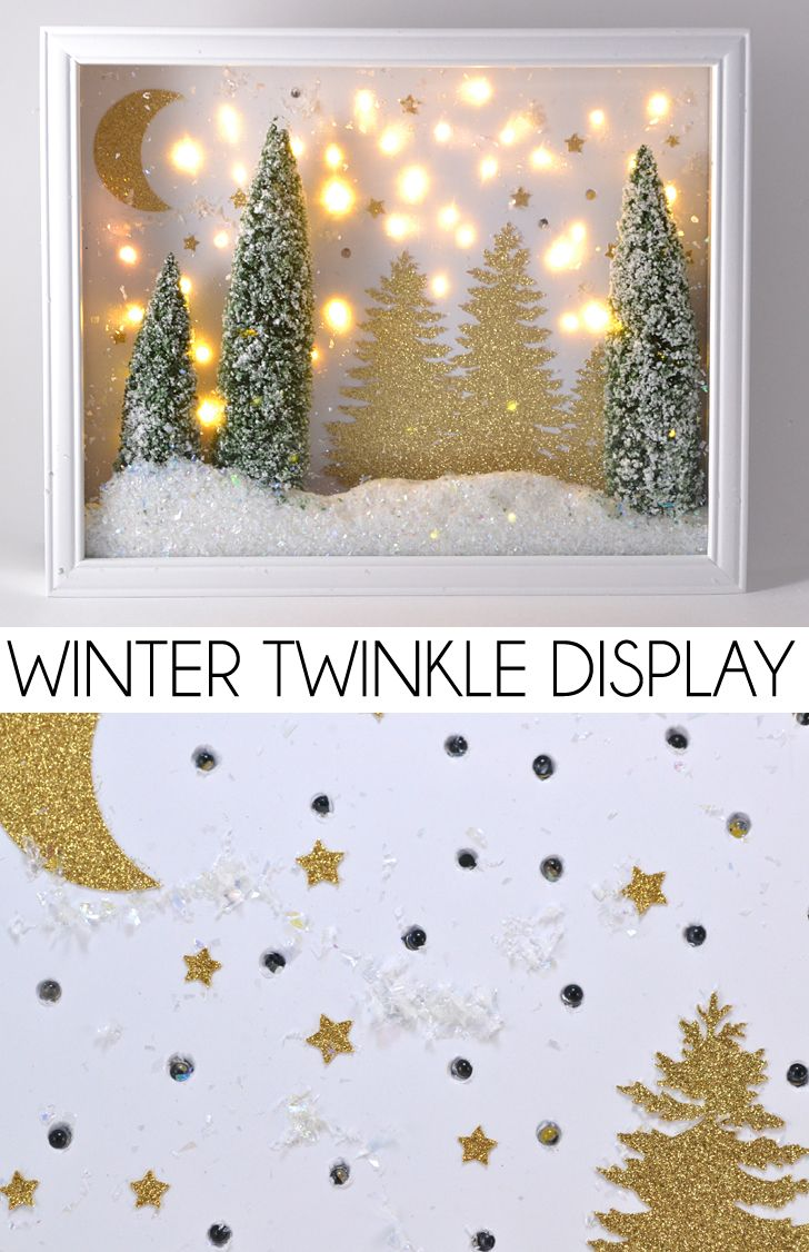 This winter twinkle light display is so pretty! Make your own with bottle brushes, buffalo snow and a shadow box. Full tutorial!