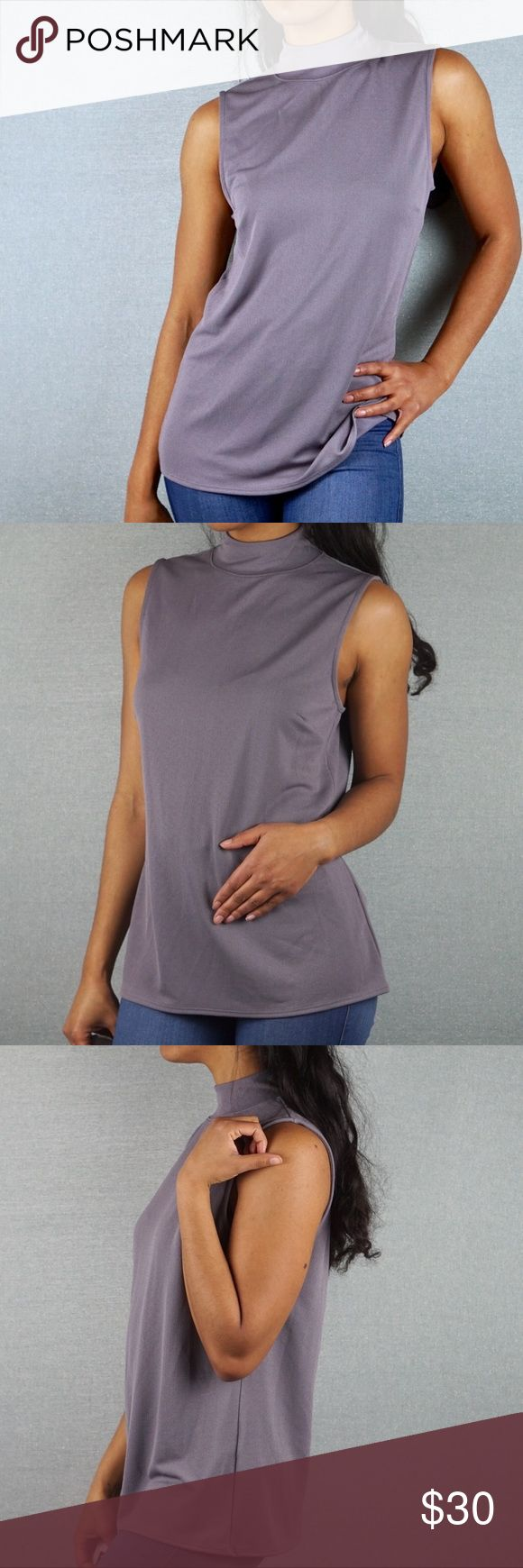 Banana Republic Gray Mock Neck Sleeveless Blouse Banana Republic Gray Mock Neck Sleeveless Blouse  Size M 92% polyester 8% elastane   Mock neck Sleeveless Buttons at the back of the neck Soft float material Material stretches Banana Republic Tops Blouses
