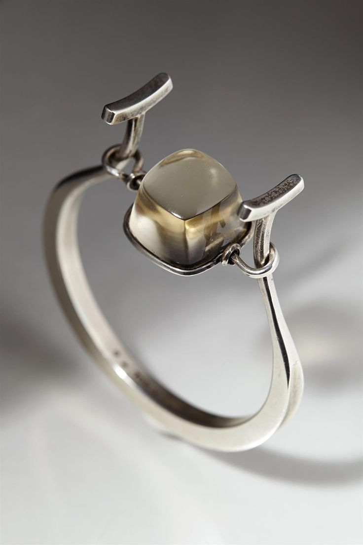 Bracelet designed by Torun Bülow-Hübe, Sweden. 1950's. - Sterling silver and rutile quartz.