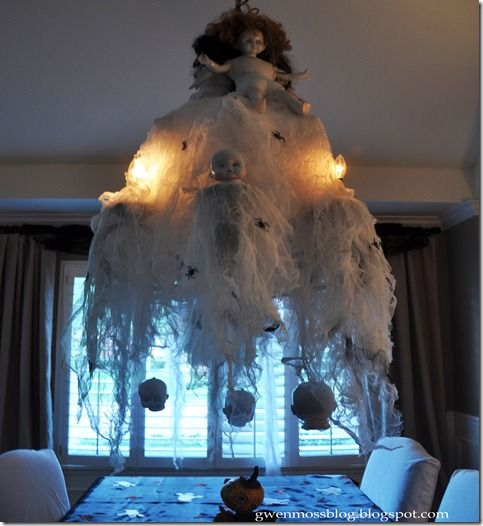 This is a good tutorial for decorating a chandelier with cheese cloth and dolls.