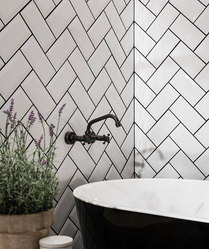 Blog - Be Daring on a Budget: 10 Really Interesting Ideas With Plain White Tile | Decoraport Canada | Another simple idea that's full of joy: Just keep the rough edge of your herringbone tile pattern so it leaves a zig-zag border, as seen here in a bathroom from Kate la Vie.