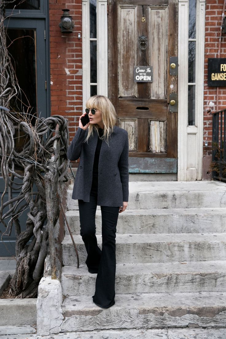 Brooke Testoni looking babe'n in black flares, cozy jacket & cool shades.
