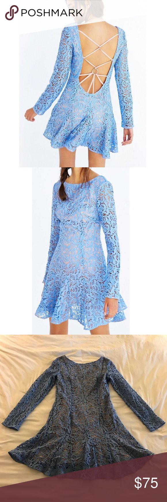 """NWT The Jersey Diaries Blue Samba Dress Size Large NWT The Jersey Diaries Blue Samba Dress Size Large. Dress is new with designer tag. Length is approx 35.5"""" shoulder to end of lace hem. Waist is approx 16"""" across. Adorable lace overlay dress with open back. Dress body is fully lined, sleeves are not lined. Blue is bright like stick photos, photos pull slightly darker...will update when I get to better light. :) The Jetset Diaries Dresses Mini"""