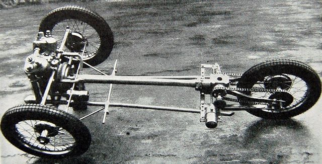 An early 2 speed chassis with rear quarter-elliptic leaf springs mounted below the bevel box.