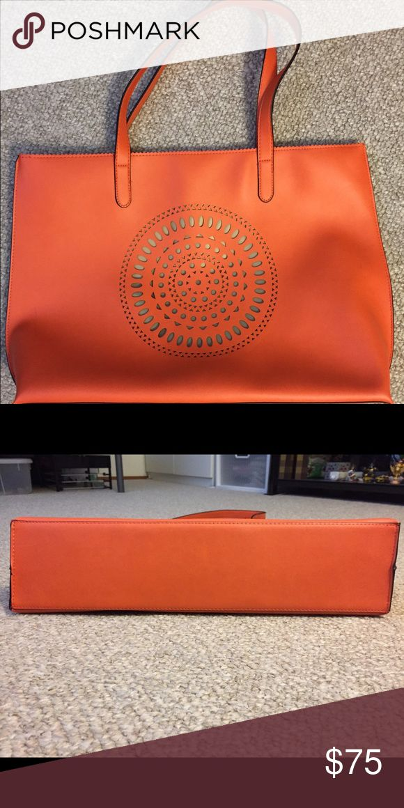 Neiman Marcus orange tote In good condition. A few surface scuffs. From a smoke and pet free home. Neiman Marcus Bags Totes
