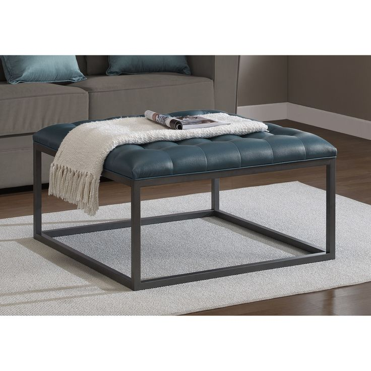 The Healy leather tufted ottoman is sure to bring style and color to your home's decor. A beautiful teal leather upholstery combines with the graphite grey metal frame to highlight the contemporary design of this ottoman.